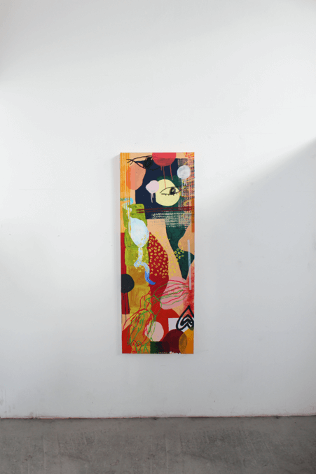 Orange collage artwork hanging on gallery wall by Hannah Fawcett