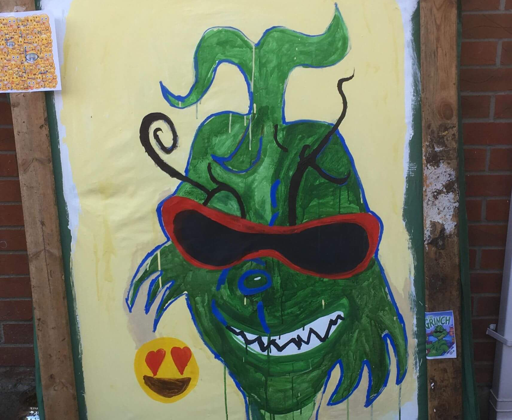 Painting of The Grinch with emoji face by Husk Bennett