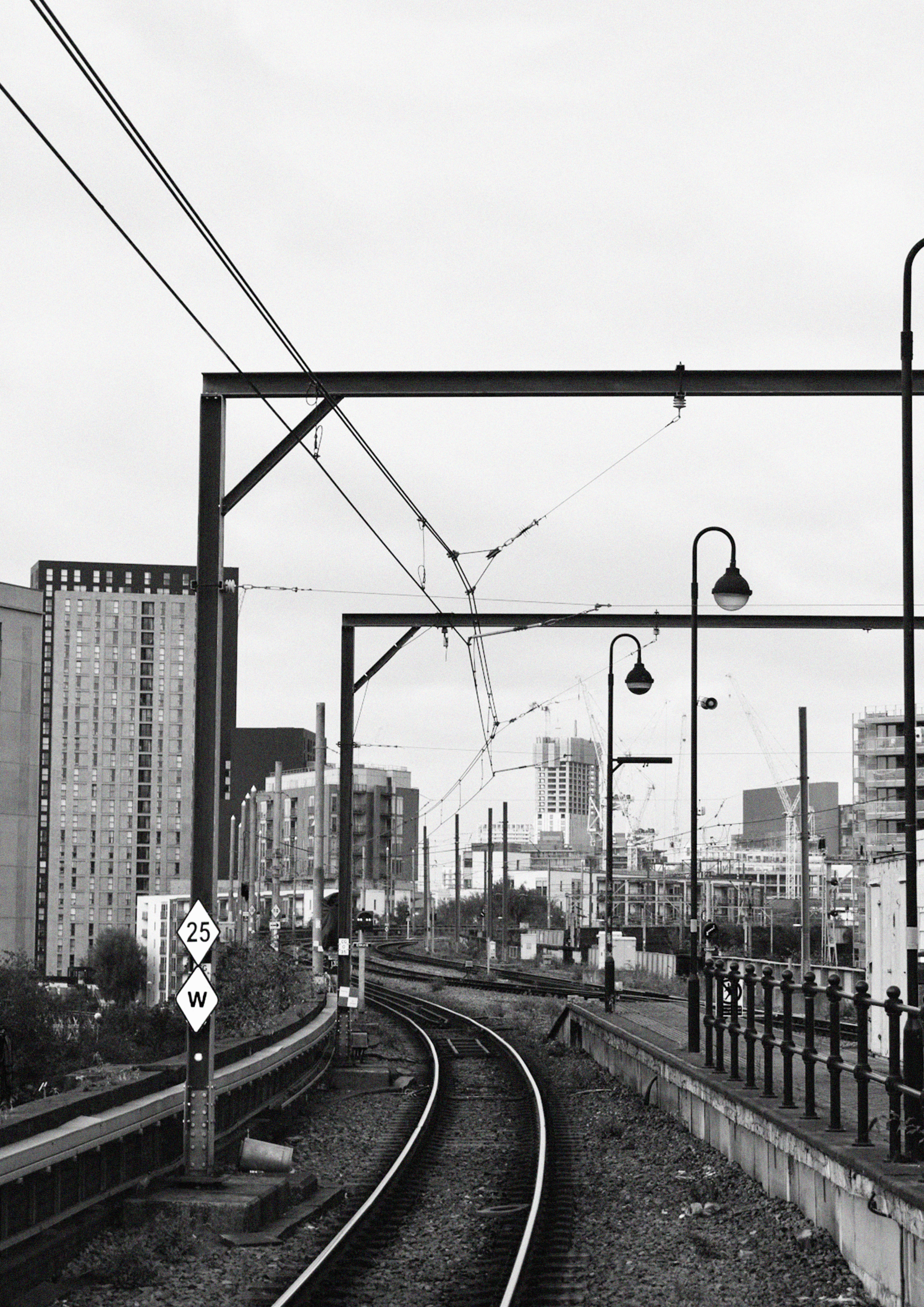 Black and white photograph of the metrolink rails.