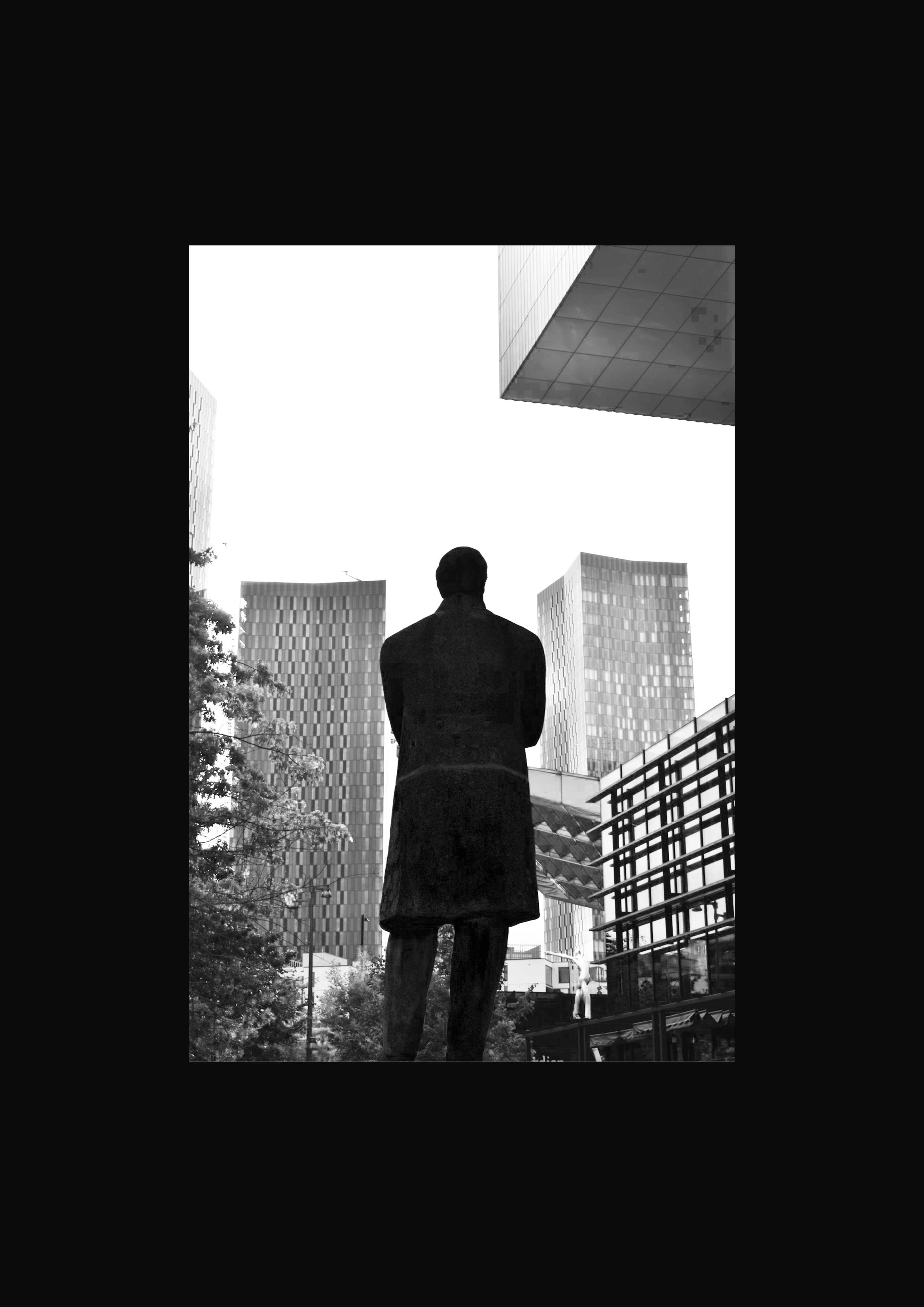 Black and white photograph on the theme of Manctopia taken in Deansgate by Nia Thomas. Manctopia.