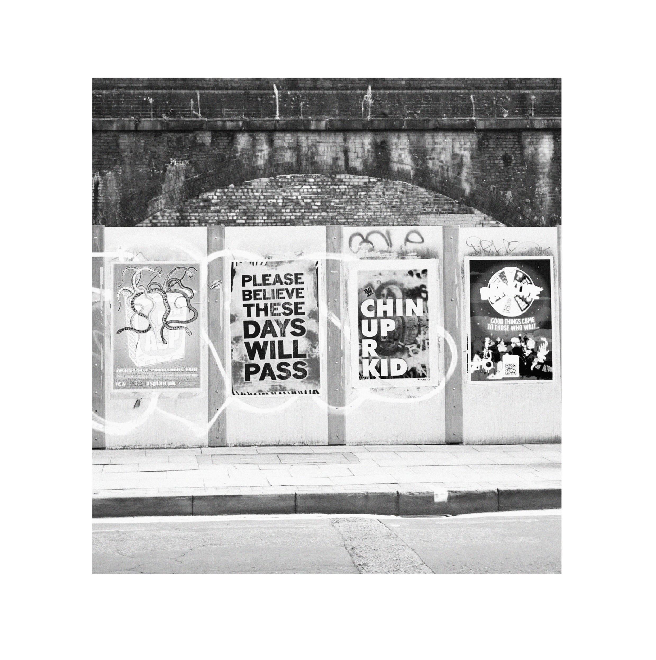 Series of posters on a wall taken by Nia Thomas. Manctopia.